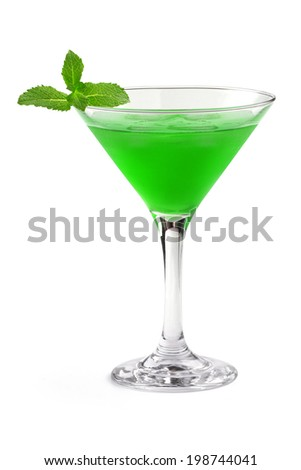 green cocktail in a martini glass on white background
