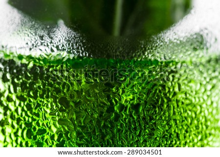 Green cocktail in glass with condensation. Macro shot. - stock photo