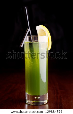 green cocktail on black background - stock photo