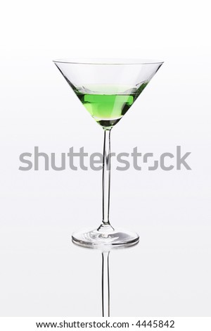 Green cocktail on white mirror like surface with clipping path