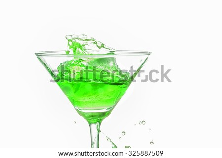Green cocktail splash on white background close up