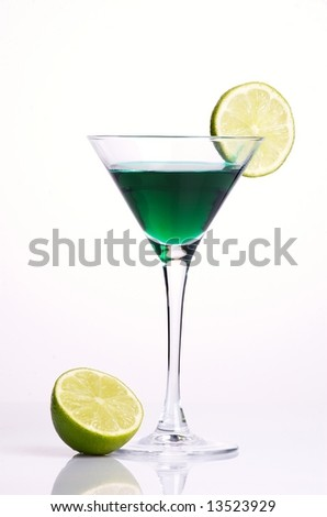 Green cocktail with green lemon on white background
