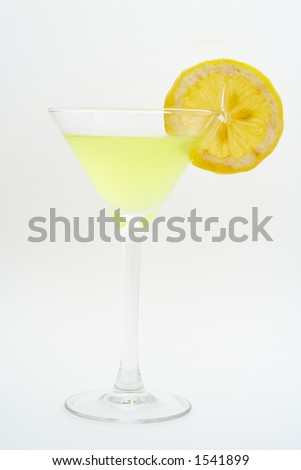 Green cocktail with lemon.  Macro shot on white background