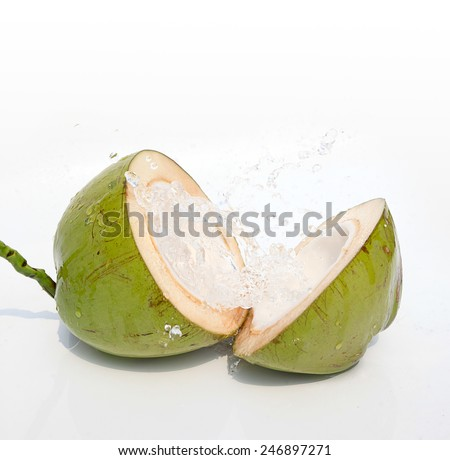 Green coconut with water splash - stock photo