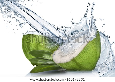 Green coconut with water splash isolated on white - stock photo