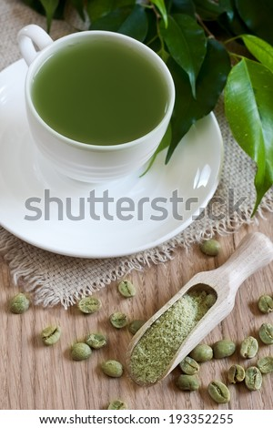 Green coffee - beans and ground. Selective focus. - stock photo