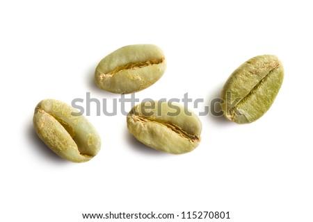 green coffee beans on white background - stock photo