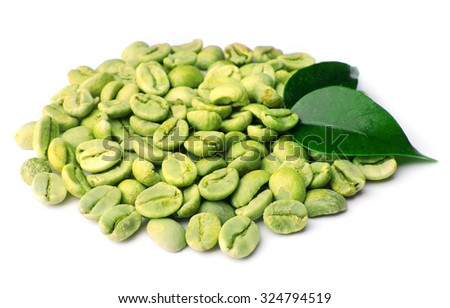 Green coffee beans with leaves isolated on white - stock photo