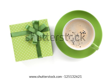 Green coffee cup and gift box with bow. View from above. Isolated on white background - stock photo