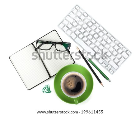 Green coffee cup and office supplies. View from above. Isolated on white background - stock photo