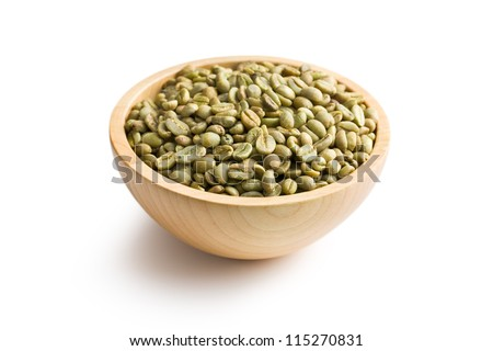green coffee in wooden bowl on white background - stock photo