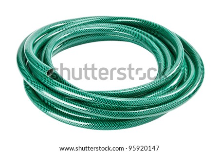 Green coiled rubber hose isolated on white - stock photo