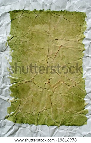 Green color framed painted crushed paper as background. Art is painted by photographer. - stock photo