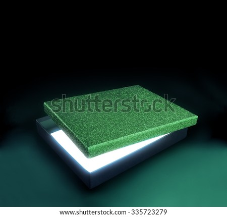 Green color gift box. Opened box against black background with copy space. Light effect inside. Clipping path on the box and inside box - stock photo