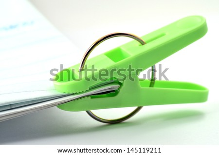 Green color of Paper or Clothes clips and pins with documents