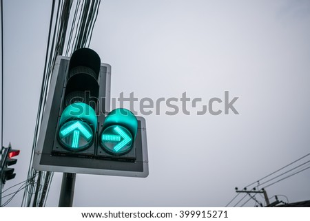 Green color on the traffic light with wire and evening clear sky background - copy space - stock photo