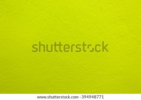 Green color paint on concrete wall:Close up,select focus with shallow depth of field:Macro shot - stock photo