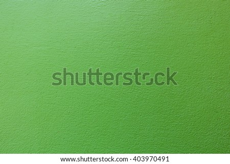 Green color paint on concrete wall:Close up,select focus with shallow depth of field:Macro shot. - stock photo