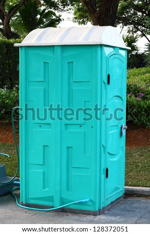 Green color Portable toilet ready to service people for outdoor event - stock photo
