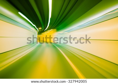 green color tunnel car driving motion blur - stock photo