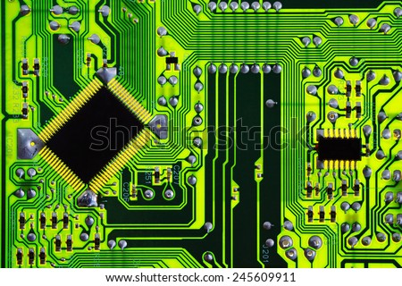 Green computer electric circuit board - stock photo