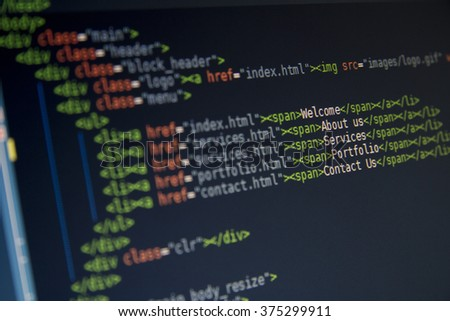 Green computer HTML code in code editor for website development, with SEO concepts for better SERP. search engine optimization for better rankings with PHP, JavaScript and CSS  - stock photo