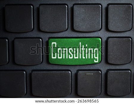 green consulting button on black keyboard  - stock photo