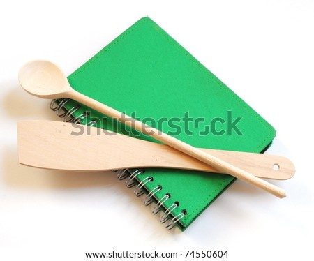 green cookbook and kitchenware isolated on white background - stock photo