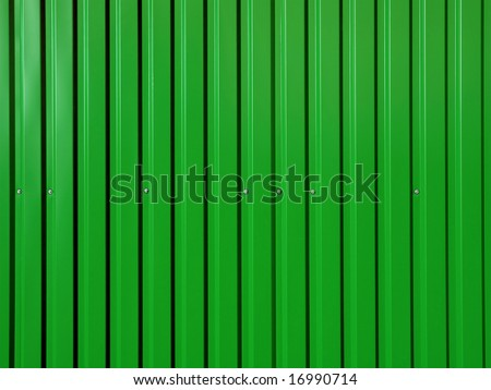 Green corrugated surface. - stock photo