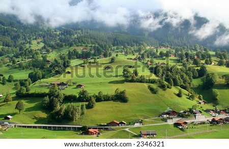 Green countryside in the clouds - stock photo