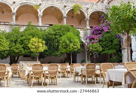 green courtyard with wood furniture