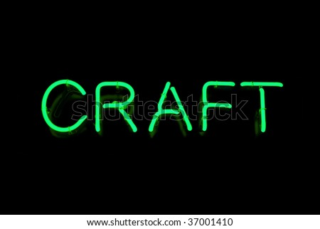 Green craft neon sign isolated on black background