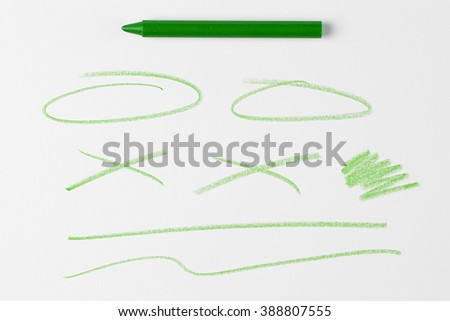 Green Crayon and Crayons scribbles and lines and Doodles Isolated on White Background with Real Shadow and Text Space. Top View