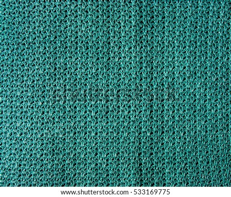 Green crocheting cloth texture with shells pattern