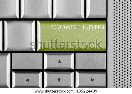 Green CROWD FUNDING key on a computer keyboard - stock photo