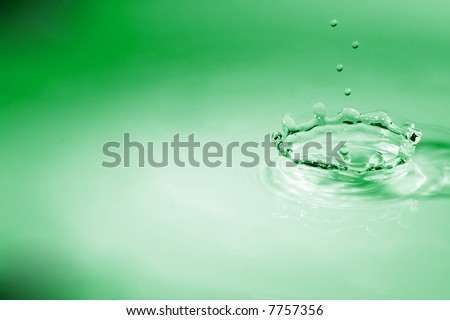 Green crown waterdrop - stock photo