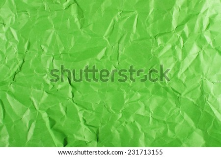 Green crumpled paper surface - stock photo