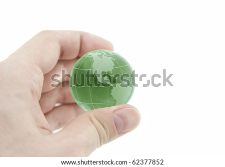Green crystal globe in hand with clipping path - stock photo