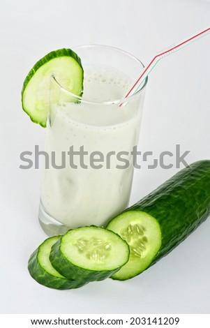 green cucumber coctail with kefir on white