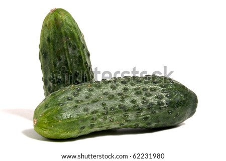 green cucumber with slices isolated on white