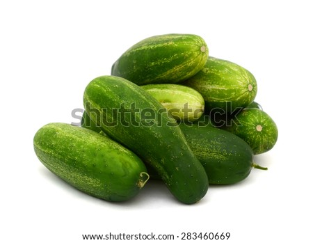 green cucumbers on white background