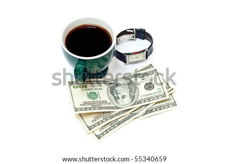 Green cup with coffee, dollars and watch isolated on white