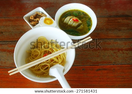 Green curry squid stuffed with pork. Eat with spaghetti This is Thailand food adapted. - stock photo