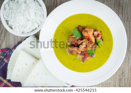 Green curry with chicken, bright, spicy Thai dishes delicious Asian dinner - stock photo