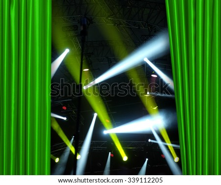 Green curtain on concert stage slightly open - stock photo