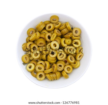 green cut olive rings in bowl on a white background - stock photo
