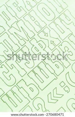 green cyrillic alphabet letters printed on white paper