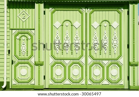 green decorated closed gate with traditional engraving