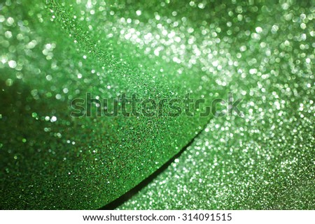 Green defocused abstract lights background. Green bokeh glitter paper background - stock photo