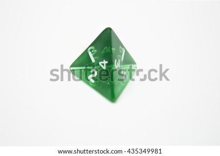 green dice d4 - stock photo